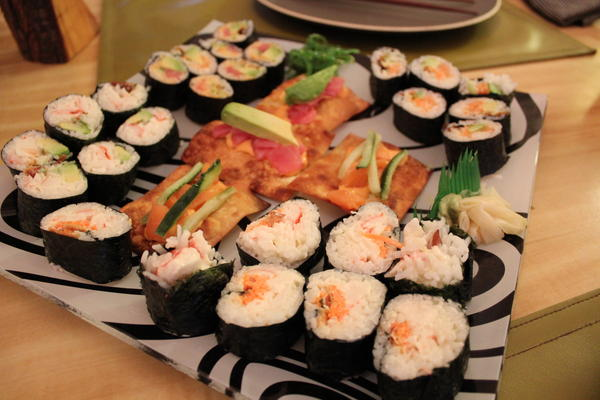 Sushi (crab rolls in the foreground)